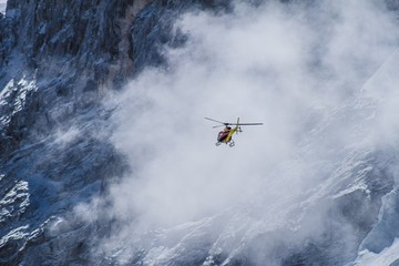 Printed kitchen splashbacks Helicopter helicopter in flight into cloud on snow mountain