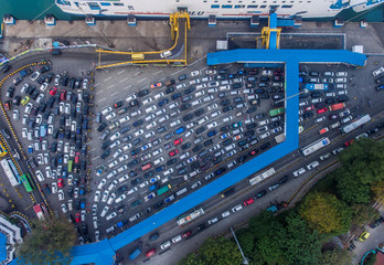 An aerial view of cars queuing for ferry boat to cross to Sumatra Island, as people head to their hometowns to celebrate the upcoming of Eid al-Fitr, at Merak port in Banten