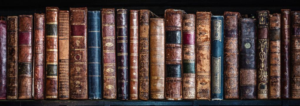 Old books on wooden shelf. Tiled Bookshelf background.  Concept on the theme of history, nostalgia, old age. Retro style.