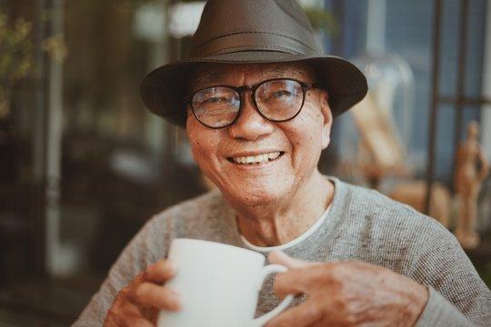 Portrait of senior man drinking coffee in cafe