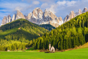 Sunny landscape of Dolomite Alps. St Johann Church with beautiful Dolomiti mountains, Santa Maddalena Wall mural
