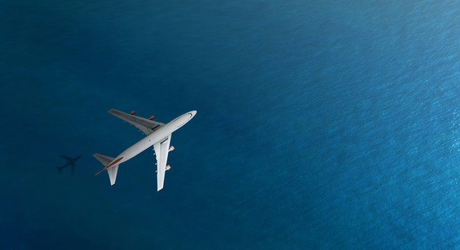 Aerial top view of Airplane flies over a sea, view from above