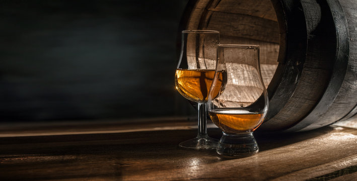Two glasses with whiskey. They are for professional tasting distillates.