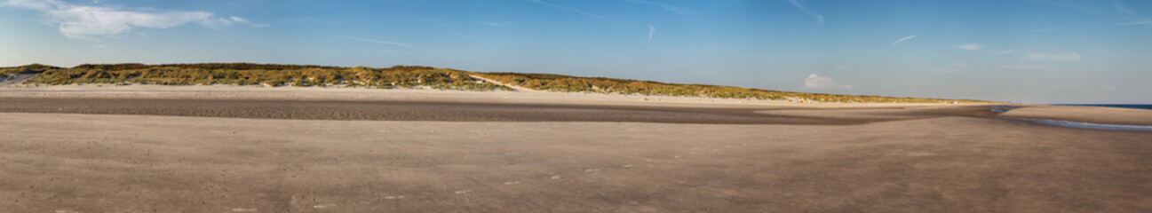 Wall Mural - Beach on the East Frisian Island Juist in the North Sea, Germany, in morning light.
