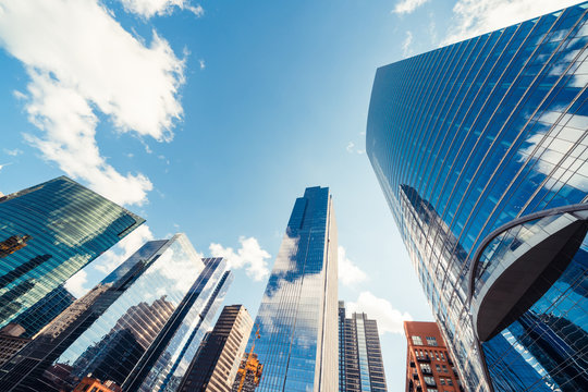 Modern tower buildings or skyscrapers in financial district with cloud on sunny day in Chicago, USA. Construction industry, business enterprise organization, or communication technology concept