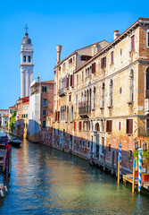 Fototapete - Street with vintage houses, Venice, Italy. Scenic view of narrow canal. Cityscape of the Venice center with ancient buildings. Scenery of old Venetian alley in summer. Hdr photo of the Venice city.