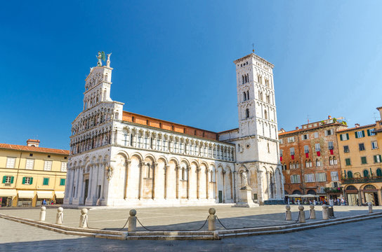 Chiesa di San Michele in Foro St Michael Roman Catholic church basilica on Piazza San Michele square in historical centre of old medieval town Lucca in summer day with clear blue sky, Tuscany, Italy