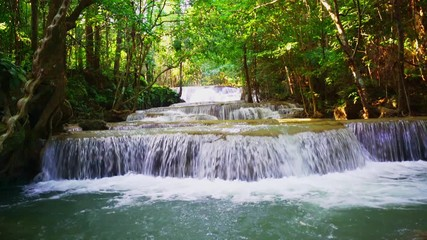Wall Mural - Locked down, Waterfall flow standing with forest enviroment low angle view in thailand called Huay or Huai mae khamin in Kanchanaburi province, Thailand., Lockdown.