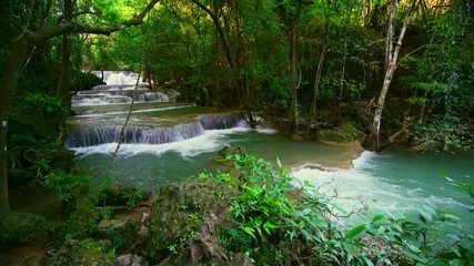 Wall Mural - Locked down, Waterfall flow standing with forest enviroment high angle view in thailand called Huay or Huai mae khamin in Kanchanaburi province, Thailand., Lockdown.