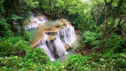 Wall Mural - Waterfall flow standing with forest enviroment from high angle view in thailand, called Huay orHuai mae khamin in Kanchanaburi province, Lockdown.