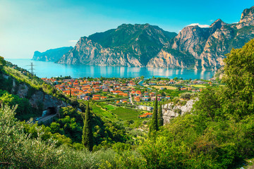 Wall Mural - Lake Garda with high mountains and Torbole resort, Italy, Europe