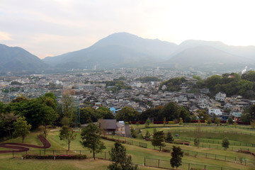 The landscape of Beppu in Oita and golf range as seen from a hill in sunset