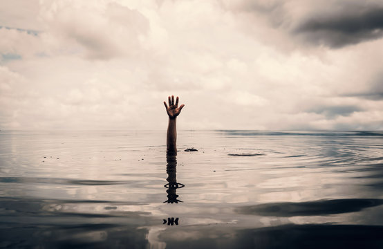 Hand of man want to helping after drown in the lake
