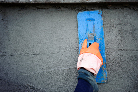 The work of a plasterer by applying plaster to the wall to have a smooth surface.