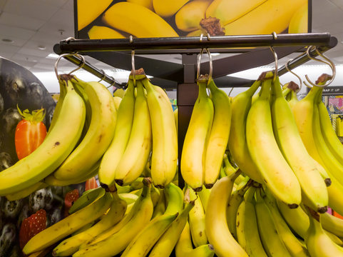 Bunches of yellow Banannas for sale inside a shop