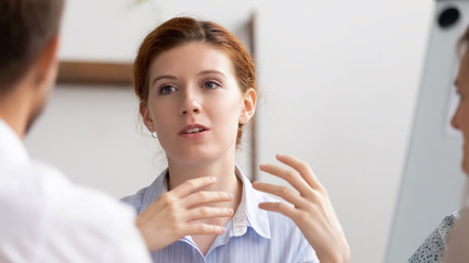 Head shot confident businesswoman, senior teacher mentor, coacher speaking