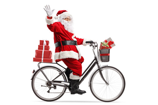 Santa Claus carrying presents on a bicycle and waving