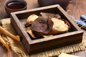 chinese dried tangerine peel in wooden box with tea