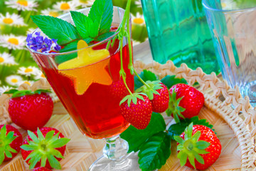 Garden party drink with strawberries and decorations