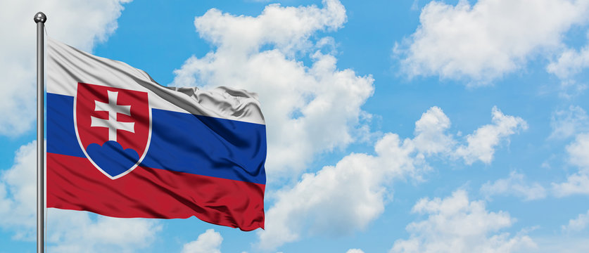 Slovakia flag waving in the wind against white cloudy blue sky. Diplomacy concept, international relations.