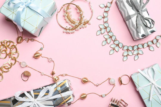 Beautiful jewelry and gift boxes on color background, flat lay. Space for text