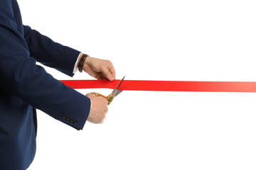 Man in office suit cutting red ribbon isolated on white, closeup Papier Peint