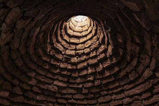 Deep ancient well inside