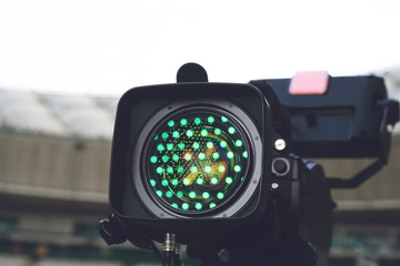 Close-up picture of a professional tv camera before broadcasting.