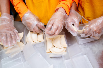Muslim workers doing food processing in the Halal foods industries