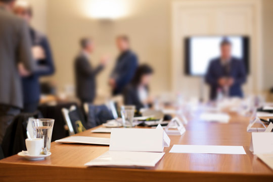 businesspeople around the table in conference room