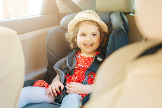 Cute little baby child sitting in car seat. Portrait of cute little baby child sitting in car seat.Safety concept.