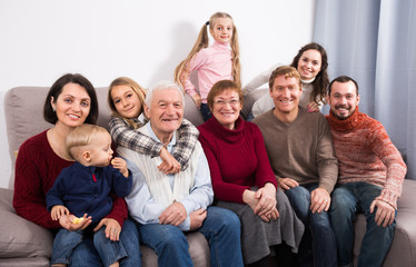Grandparents 60-70 years old with children are photographing best moments