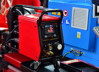 Inverter welding MIG machine. Equipment for welding metals in a protective inert gas environment. - Image Wall mural
