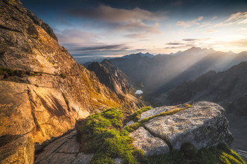 Mountains Landscape with Rock and Grass in Foreground at Sunrise. Bielovodska Valley as seen from Sedlo Vaha in High Tatras, Slovakia