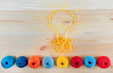 Wall Mural - Concept of idea and innovation with wool ball.