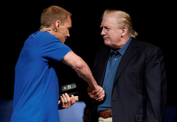 U.S. President Donald Trump shakes hands with Pastor David Platt after he prayed for him at the McLean Bible Church, in Vienna