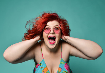 Shouting laughing loud overweight fat woman holds her head with hands can't believe huge discount sale or crazy luck