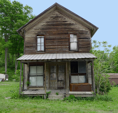 abandoned old wood plank farm house