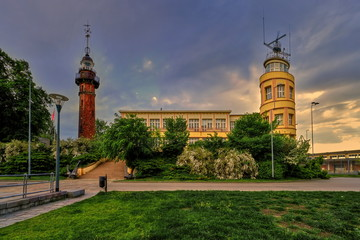 Obraz Lighthouse - a historic lighthouse on the Polish coast of the Baltic Sea, located in the Nowy Port district of the city of Gdańsk, Poland.  - fototapety do salonu