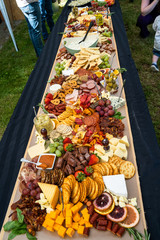 Delicious fresh meat, cheese, bread and fruit.