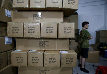 "Boxes of gun cases with the words ""Made in China"" are stacked up in a factory of firearm equipment manufacturer Yakeda Tactical Gear Co, which exports most of its products to the United States, in Guangzhou"
