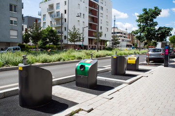 Waste bins in a city centre of Massy in France in front of a building