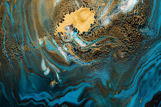 Acrylic Fluid Art. Abstract marble background or texture. Blue sapphire waves and gold spots curls