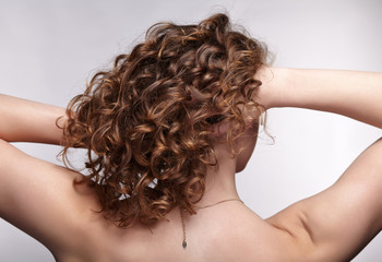 Woman from backside with curly hair
