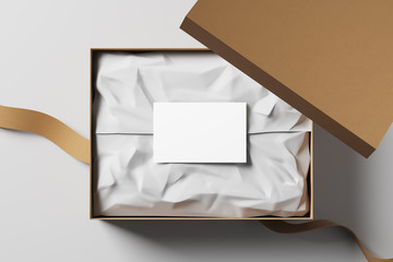 Open realistic cardboard box with white packaging card and fabric tape. The concept of a business gift. Mock up. Top view. 3d rendering