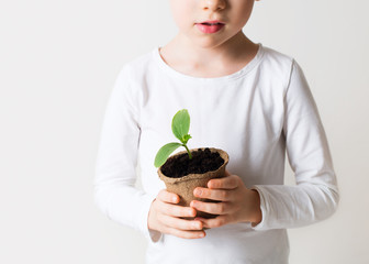 Little boy with sprouts, ecology theme on white background. Wall mural