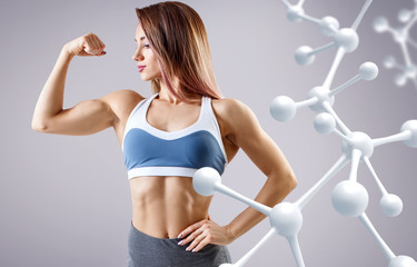 Sporty young woman posing near molecules structure.