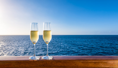 Glasses of sparkling wine on vacation. Sea background. Copy space.