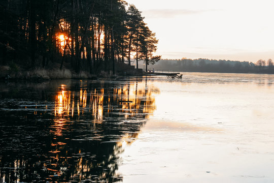 Sunset over the freezing lake