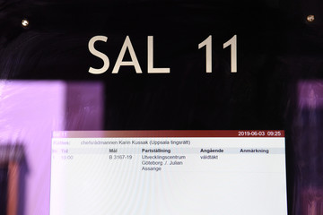 A sign is seen at Uppsala District Court, where the detention hearing regarding WikiLeaks' founder Julian Assange is being held, in Uppsala